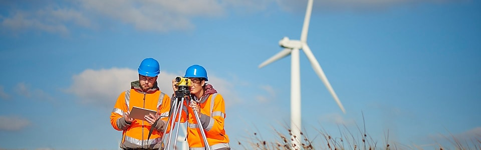Two wind farm engineers