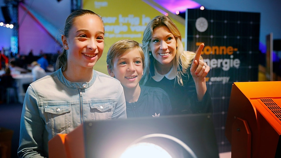 Visitors interact with a display at Generation Discover 2018, in The Hague, Netherlands, a place where young people can experience science and technology.